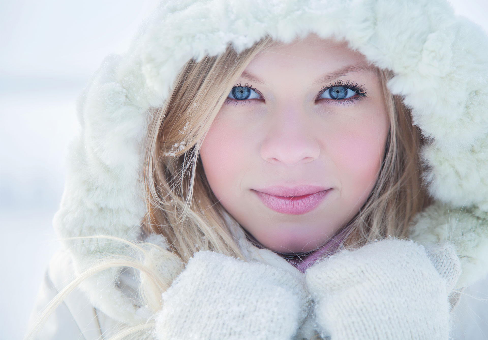 a model dressed for winter with lips protected from harsh weather
